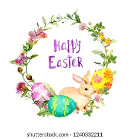 """Easter wreath with bunny, colored eggs in grass and flowers. Circle frame with text """"Happy Easter"""". Watercolor"""