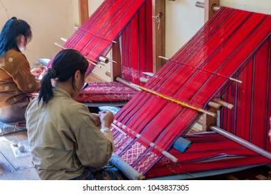 Eastern Bhutan, near Trashigang - October, 20, 2010: Bhutanese woman weaving. Women of eastern Bhutan are skilled at weaving and some of the most highly prized textiles are woven by them.