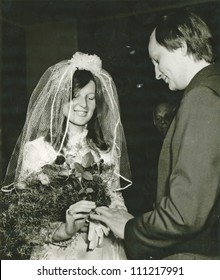 EASTERN BOHEMIA, CZECHOSLOVAKIA, CIRCA 1972 - Bride and Groom, photos from the wedding hall - exchange wedding rings - circa 1972