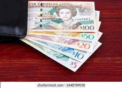 Eastern Caribbean dollars in a black wallet