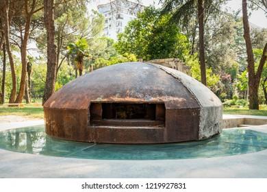 Eastern europe city concrete bunker in a memorial park in Tirana Albania.
