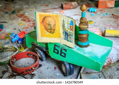 Eastern Europe, Ukraine, Pripyat, Chernobyl. Toys in the kindergarten. Children's book with picture of Lenin sits in a dumptruck. April 11, 2018.