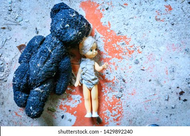 Eastern Europe, Ukraine, Pripyat, Chernobyl. Toys in the kindergarten. A badly burned teddy bear and a doll.