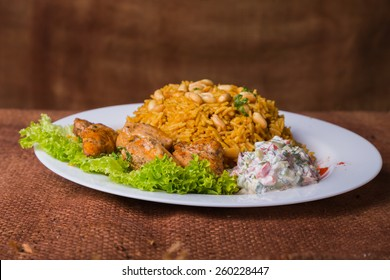 Eastern food. Arab food. Pilaf with meat. Rice with meat and vegetables. Healthy eating, delicious food.