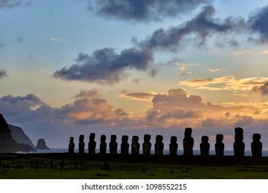 EASTERN ISLAND - NOV 19:  john does people waiting the sunrise at Ahu Tongariki, the largest ceremonial platform on Rapa Nui national park. Nov 19, 2017 in Eastern Island, Chile