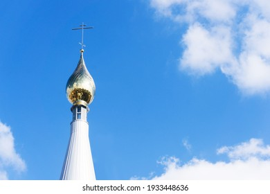 Eastern Orthodox church. Golden dome monastery. Roof domes architecture background. Christian religion cathedral. Blue sky background. Bialystok city in Poland. Empty copy space religious background.