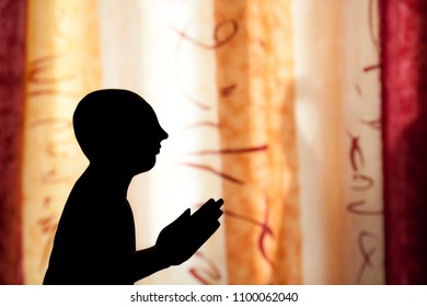 Eastern philosophy. Ancient wisdom and spirituality of the East. Silhouette of a philosopher monk praying in front of an oriental theme background. Meditation and mindfulness.