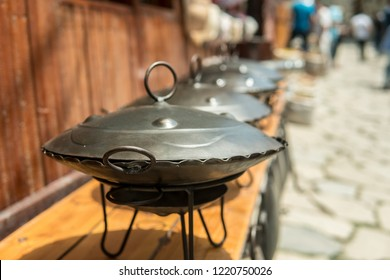 Eastern Saj pots for barbacue or kebap for sale at the market.