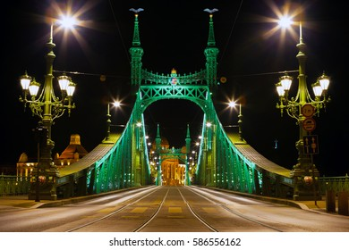 Eastern side of Freedom Bridge with National emblem on it in Budapest, Hungary