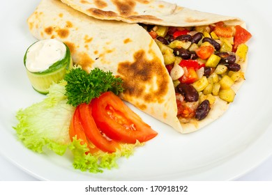 eastern spicy burrito with beans and squash