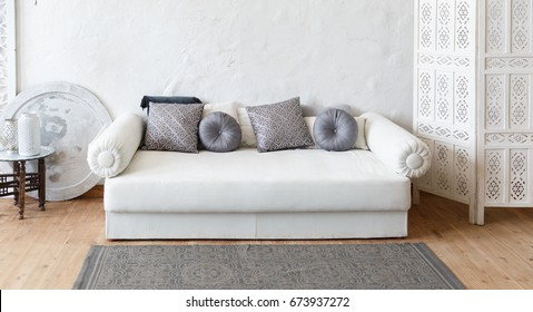 Eastern traditional interior. Morocco style room. White and gray room with beautiful white sofa and pillows