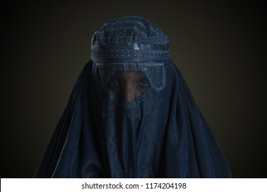 Eastern woman wearing the burqa isolated on a neutral background