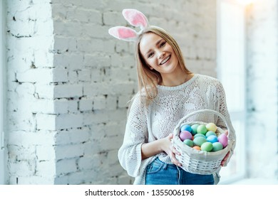Easter's my favorite holiday!Beautiful young woman with basket of easter eggs.