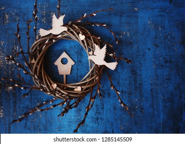 easter/wedding/housewarming card with easter wreath ,figures of wooden birds and eggs