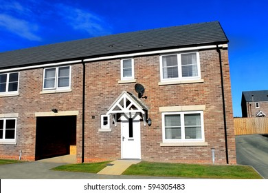 EASTFIELD, SCARBOROUGH, NORTH YORKSHIRE, ENGLAND - 10th of October 2016: New build housing estate pictureed in Scarborough on 10th October 2016. Exterior of new unoccupied houses.