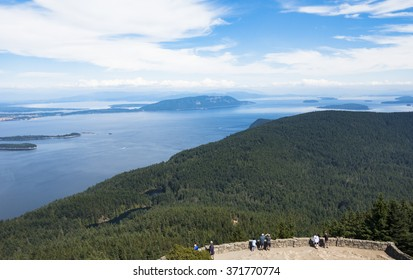 Eastsound, Orcas Island, Washington/USA - July 2015: People observe the San Juan Islands from a viewpoint at Moran State Park on Mt. Constitution
