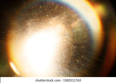 Easy to add overlay or screen filter over photos. Abstract sun burst. Digital lens flare background. Gleams rounded and hexagonal shapes, rainbow halo, iridescent glare.