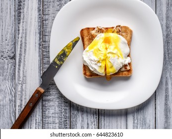 Easy breakfast of eggs benedict on a beautiful wooden background