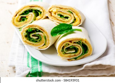 Easy Breakfast Roll-Ups with omelet ,cheese and spinach .selective focus