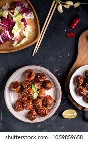 Easy Homemade Teriyaki Meatballs are coated in a sweet and savory sauce. Meatballs served with Salad.