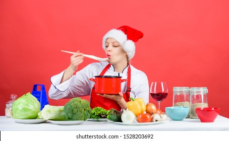 Easy ideas for christmas party. Healthy christmas holiday recipes. Woman chef santa hat cooking hold wooden spoons. Best christmas recipes. Christmas dinner idea. Cooking for family. Try main meal.