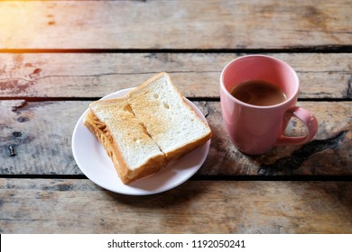 Easy morning breakfast with toasted and hot coffee.