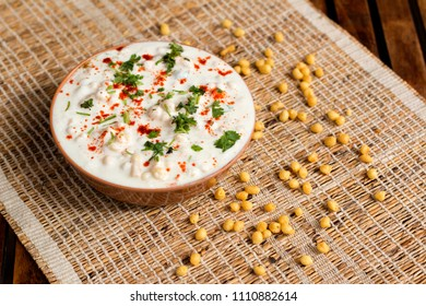 Easy, tasty, mildly spiced yogurt with salted boondi. This raita is a healthy and delicious accompaniment made with yogurt.