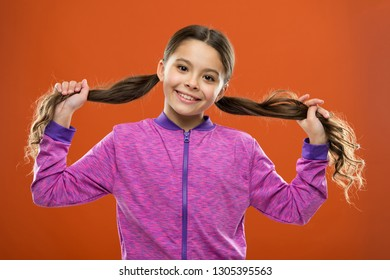 Easy tips making hairstyle for kids. Small child long hair. Charming beauty. Girl active kid with long gorgeous hair. Strong and healthy hair concept. How to treat curly hair. Nice and tidy hairstyle.