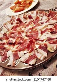 eat acorn-fed Iberian ham, in Spain,