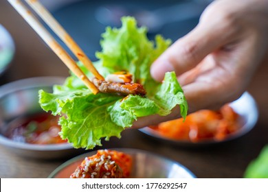 eat BBQ grilled pork with vegetable wrap korean style,Barbecue