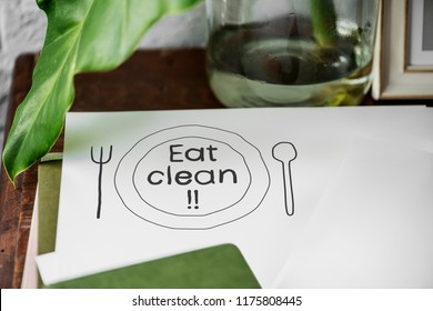 Eat clean food inspiration on written on a paper