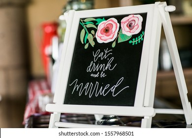 Eat, drink, and be married sign at wedding bar