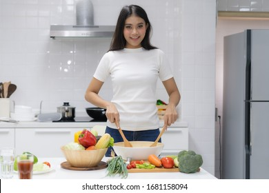 Eat healthy food for good wellness health concept. Woman cooking salad menu with fresh organic vegetables