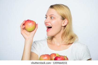 Eat healthy food. sensitive teeth. vitamin diet. Nature. farming green life. healthy food. Happy woman eating apple. autumn harvest. Spring seasonal fruit. orchard, gardener girl with apple basket.