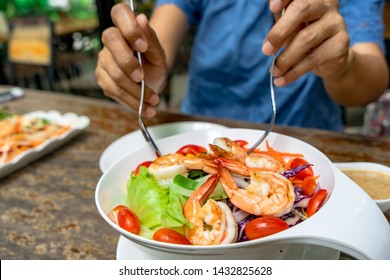 Eat healthy live healthy concept by eating organic grilled shrimps salad bowl