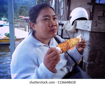 Eat her Favorite Roasted Corn At Lake Beratan Bedugul Bali Indonesia