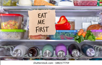 Eat Me First handmade sign in fridge, eat food first area to help reduce food waste, know where to look first, simple reduce food waste concept.