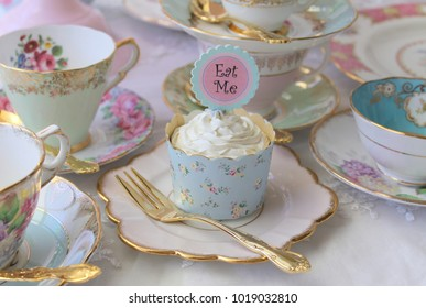 Eat Me iced cupcakes on a vintage plate with teacups gold cake fork - high tea party