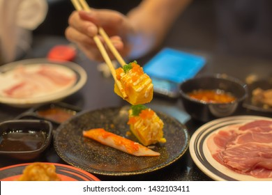Eat sushi as a dinner at the mall.