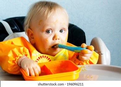 eating baby boy with dirty face
