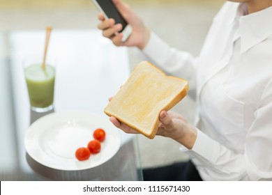 Eating breakfast business woman