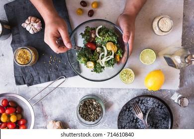 eating detox salad avocado kale brussels sprouts salad dinner food hands eating green salad