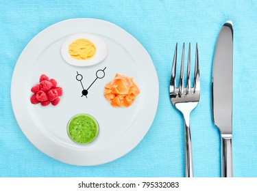 Eating during the day: Boiled egg and raspberry, fish and smoothies on the table. Concept of a diet.