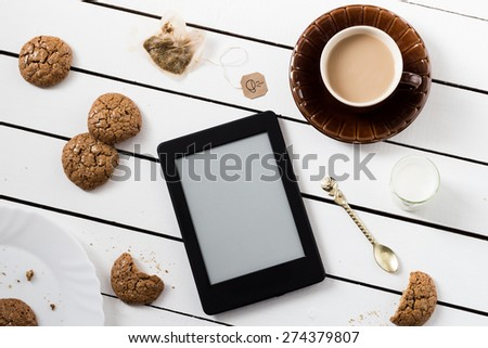 Eating and E-Reading. Flourless Walnut Cookies and Black Tea with Milk
