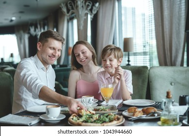 Eating family at a dinner in a restaurant