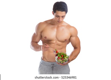 Eating food salad bodybuilding bodybuilder body builder building muscles young man isolated on a white background