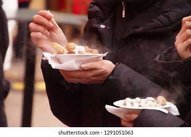 Eating fried mushrooms and cream sauce at the Christmas market,Cologne, Germany