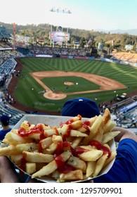 Eating fries at the ballgame