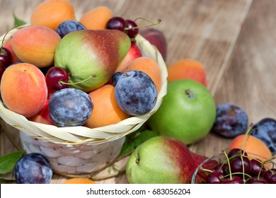 Eating healthy food - fresh organic fruits in wicker basket and on table