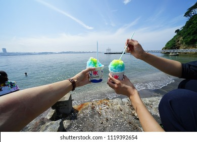 Eating ice by the sea